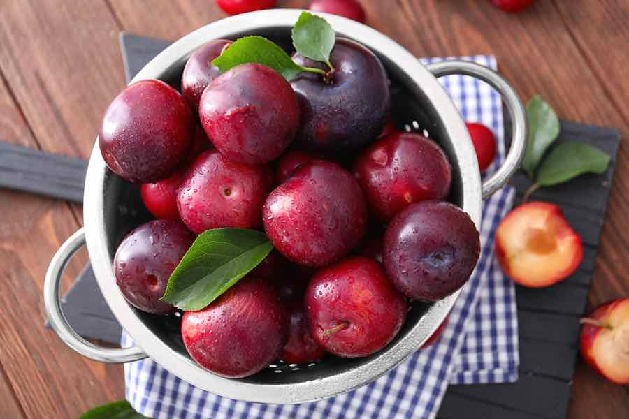 Bowl of Plums on a table
