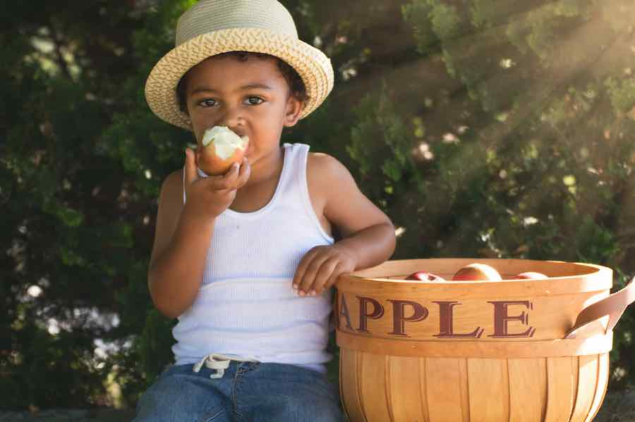 Boy Eating Honeycrisp Apple