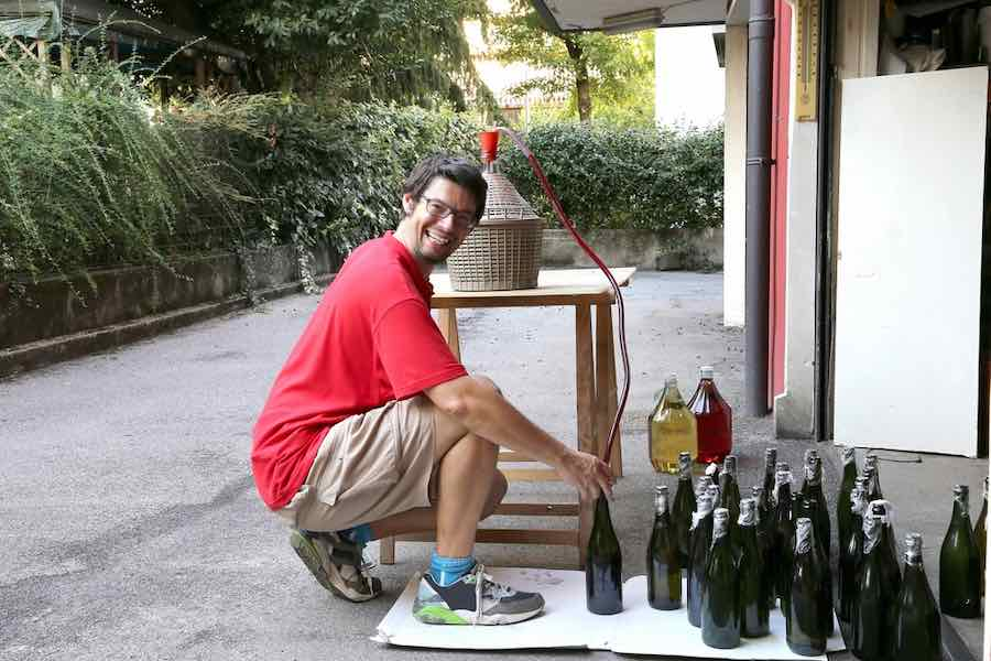 Man Bottling Wine