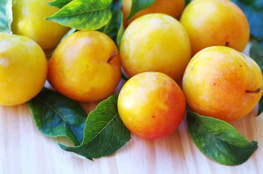 Yellow Plums on a Table