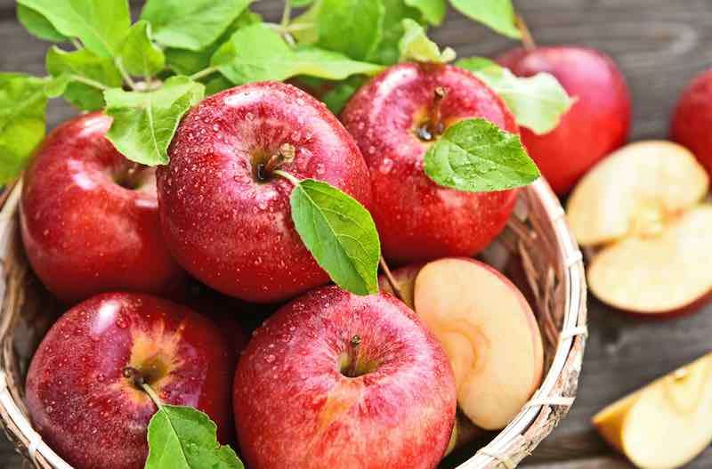 Ripe, red apples in a basket.