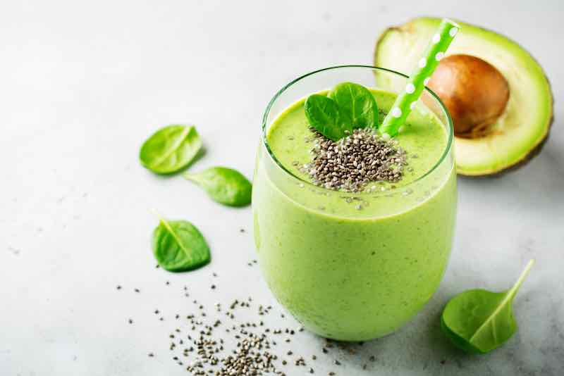 Vegetarian healthy green smoothie from avocado, spinach leaves, apple and chia seeds