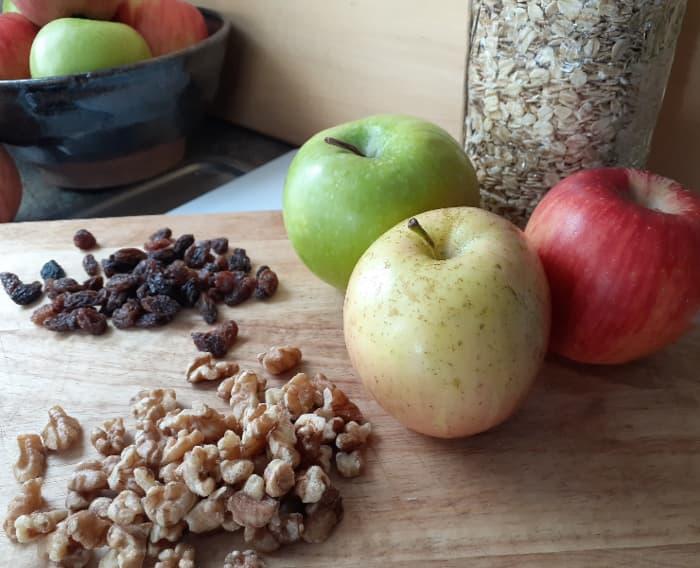 Apples, oats, raisins, and walnuts.