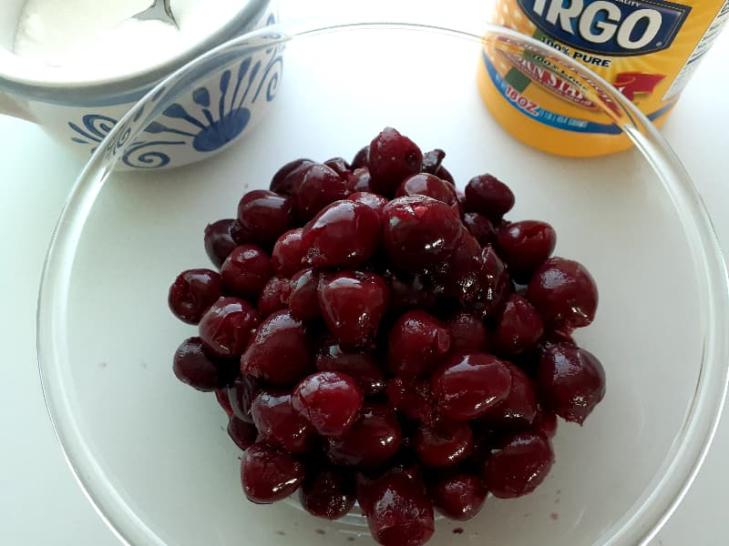 Drained cherries in a bowl.