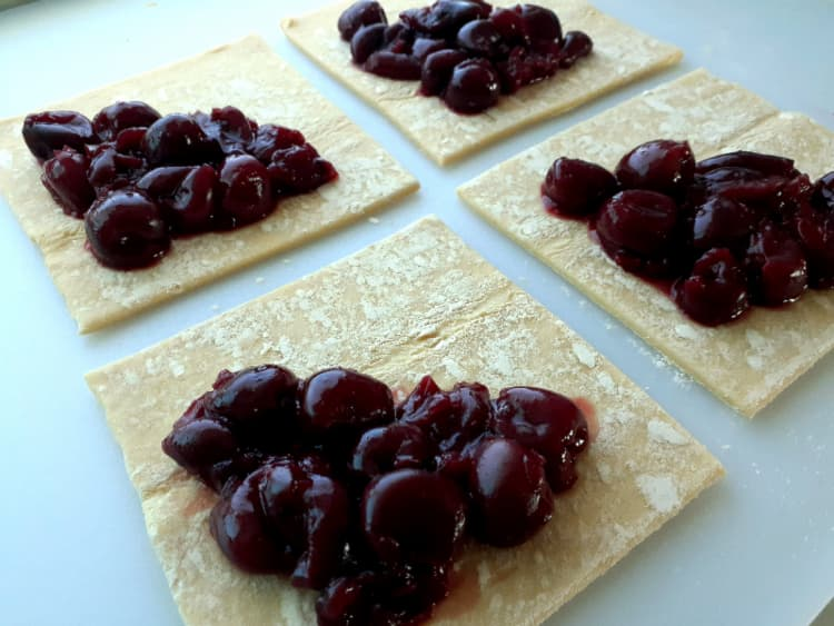 Cherry Turnover filling on pastry squares.