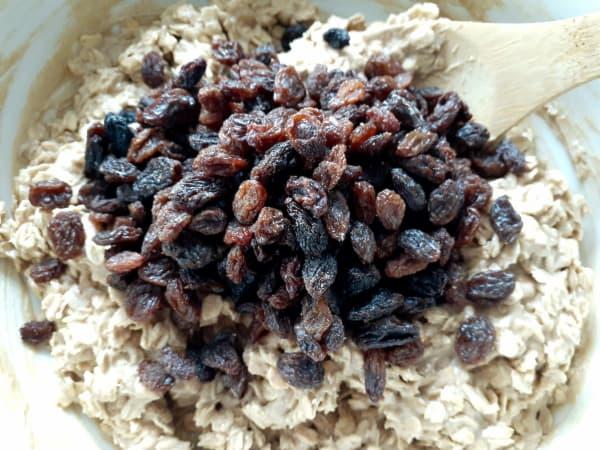 Add raisins to dough.