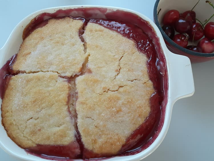 finished cherry cobbler in a pan