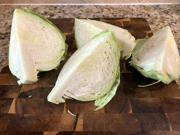 The cabbage head cut into fourths.