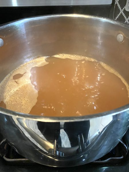 Simmering the apple cider to make concentrate.