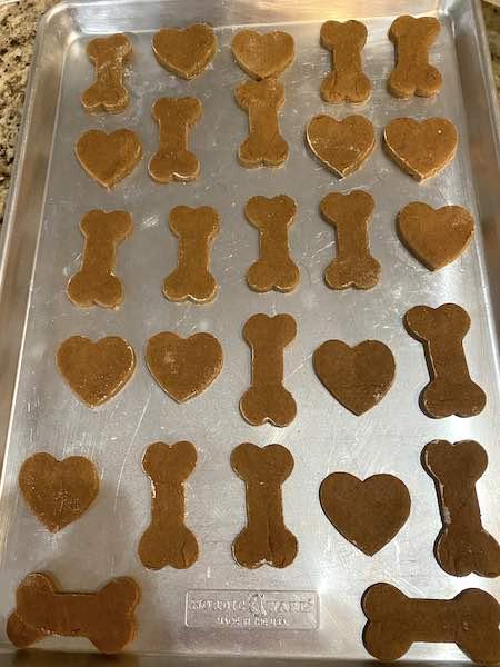 Homemade peanut butter dog treats ready to bake.