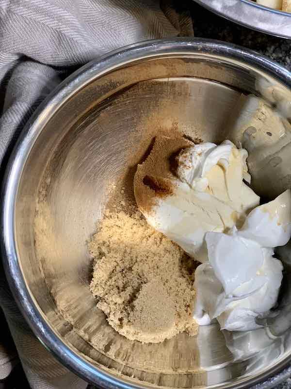cream cheese, sour cream, brown sugar, vanilla, nutmeg, and cinnamon in a bowl