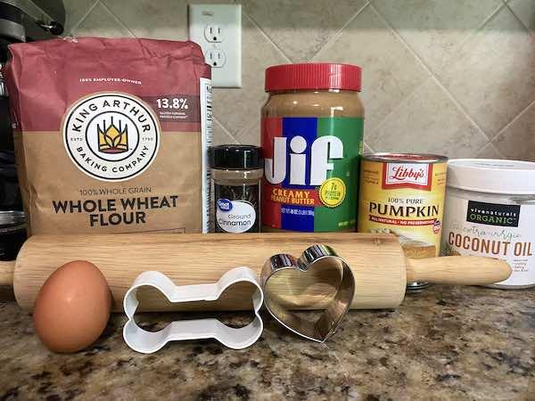 Ingredients for homemade peanut butter pumpkin dog treats.
