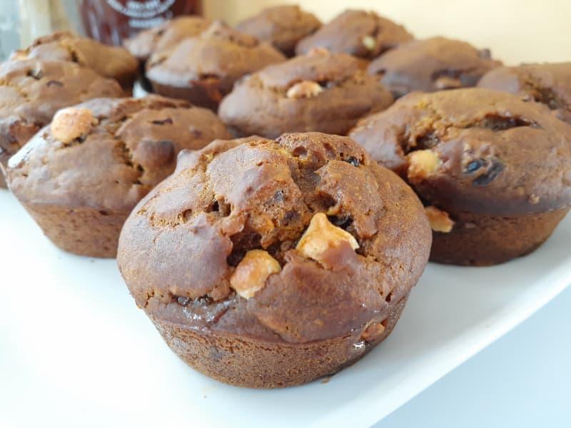 Closeup of unglazed pumpkin muffins on a white plate.