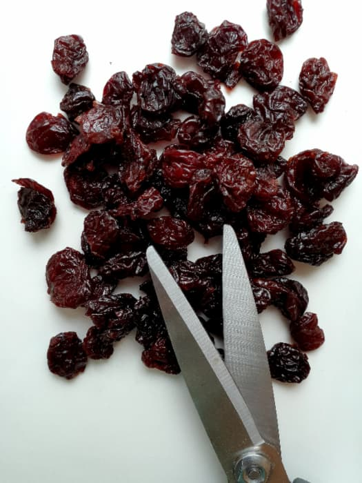 Dried cherries and kitchen shears.