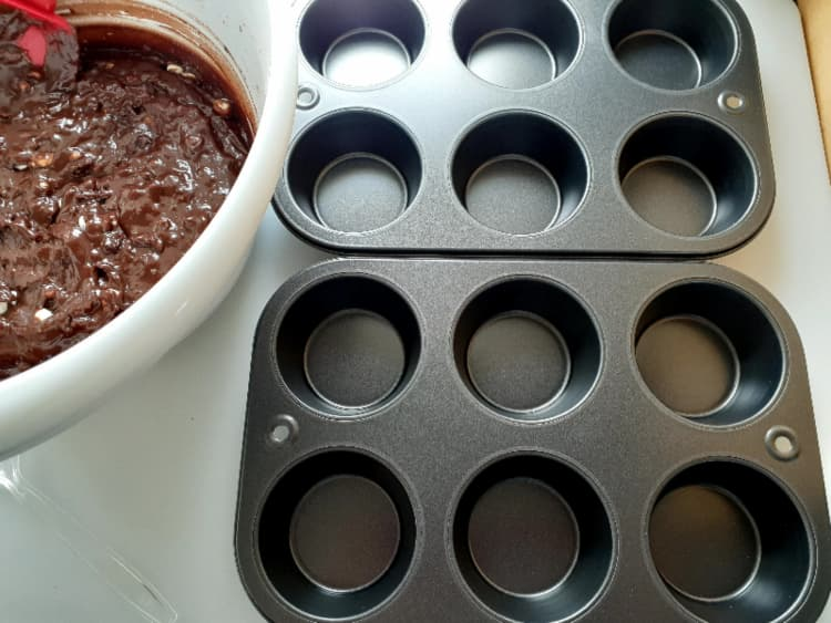 Muffin pans and batter.