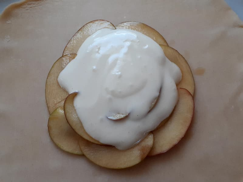 Cream cheese filling spread onto the apple layer.