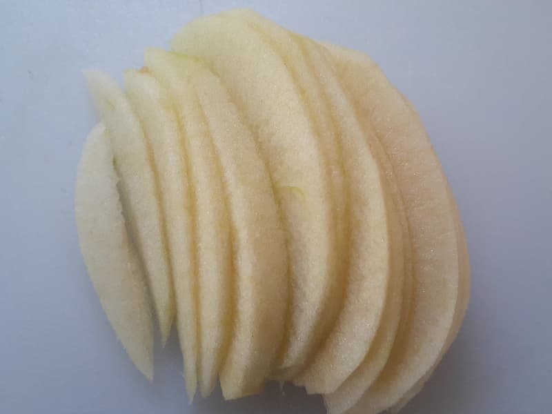 Closeup of an apple quarter cut into fan slices.