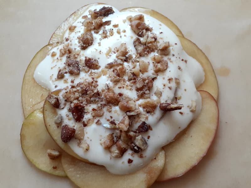 Crushed walnuts and pecans sprinkled on the cream cheese filling.