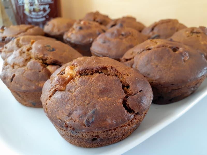 Unglazed pumpkin muffins on a white plate.