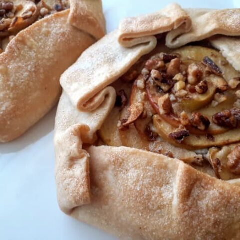 Apple Cheesecake Galettes on a white plate.