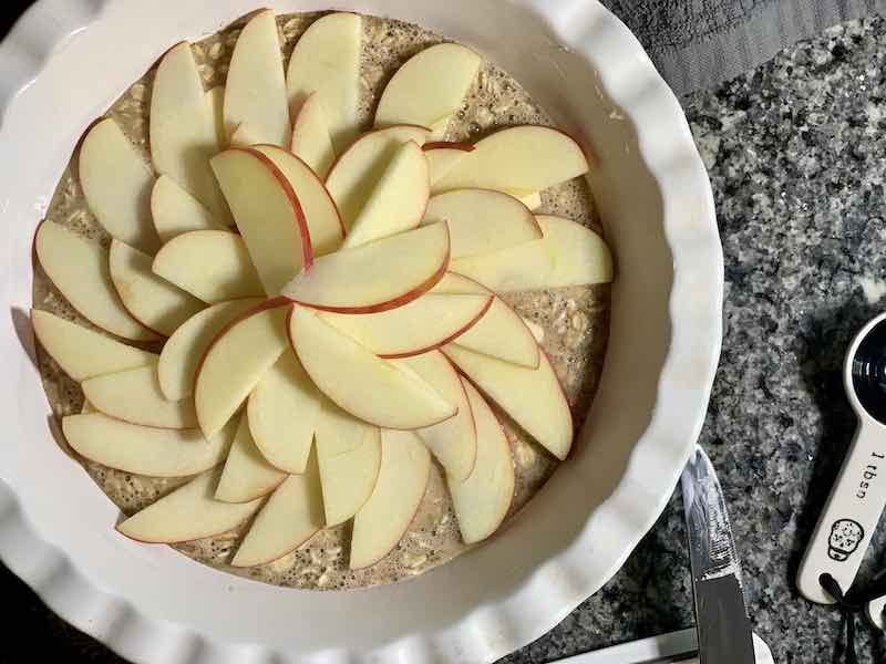 Apple slices on top of oatmeal.