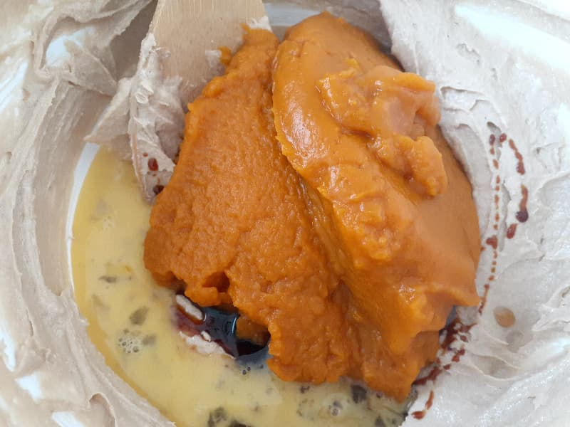 Pumpkin puree, molasses, vanilla, and a beaten egg added to the creamed butter and sugar.