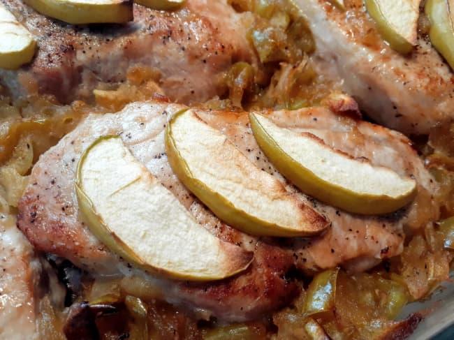 Closeup of applesauce pork chops.