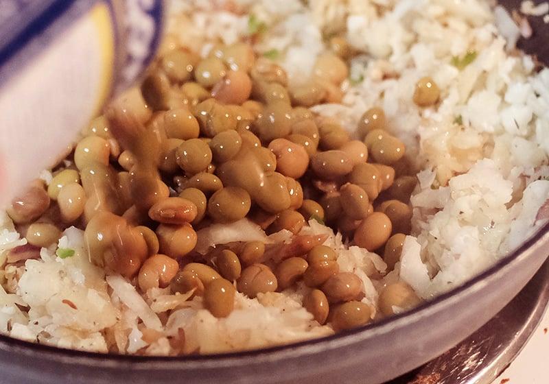 Closeup of riced cauliflower and peas.