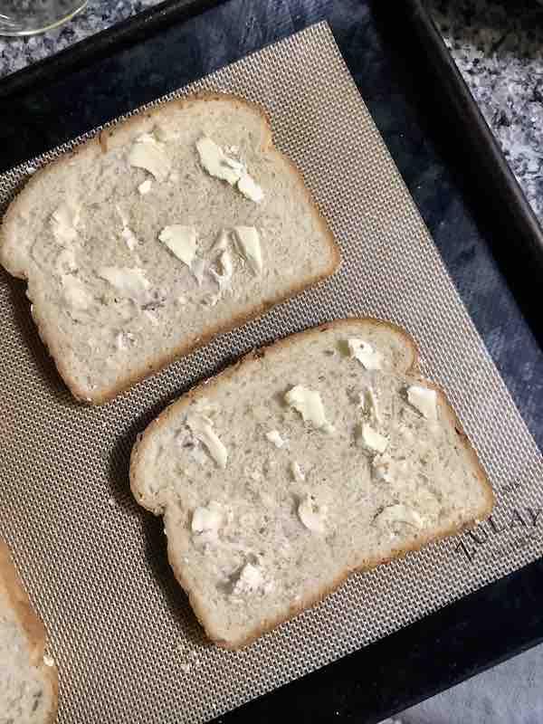 Buttered Bread On Baking Sheet