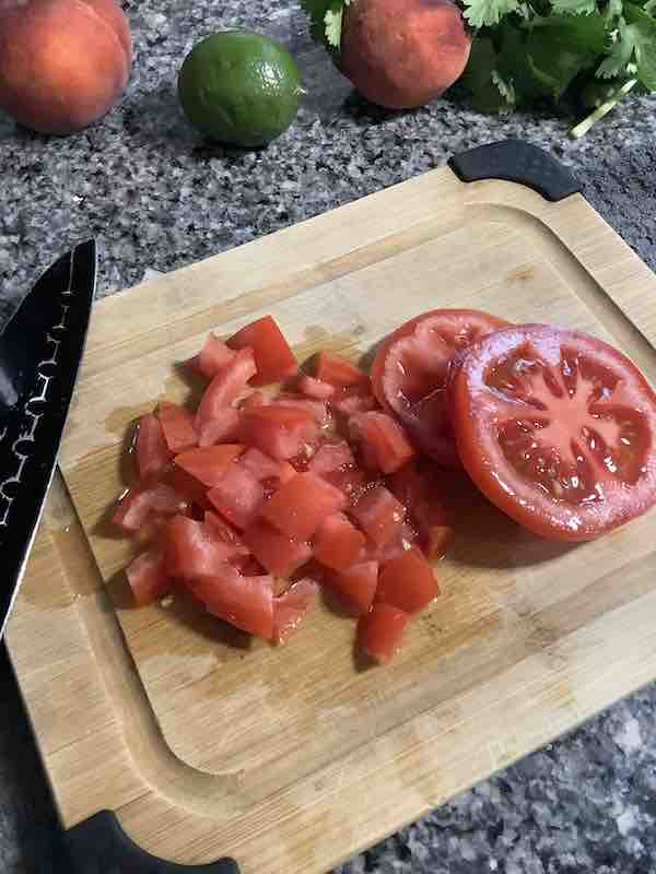Diced tomatoes on a wood cutting board.