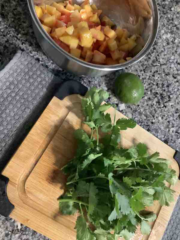Fresh cilantro on the cutting board.