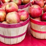 red apples in baskets