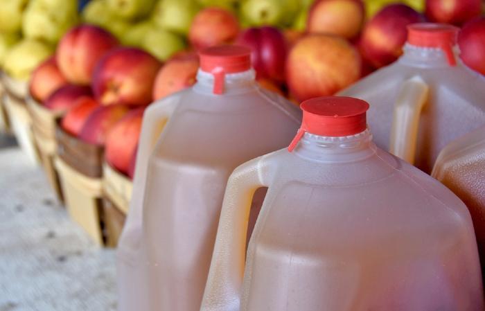 Fresh apple cider in jugs