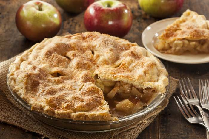 Fresh apple pie on wooden tablle.