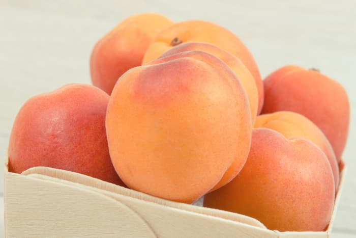 Closeup of apricots in a basket.