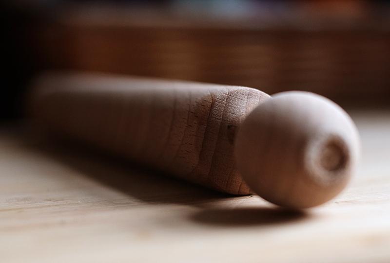 Closeup of rolling pin taken at an angle.