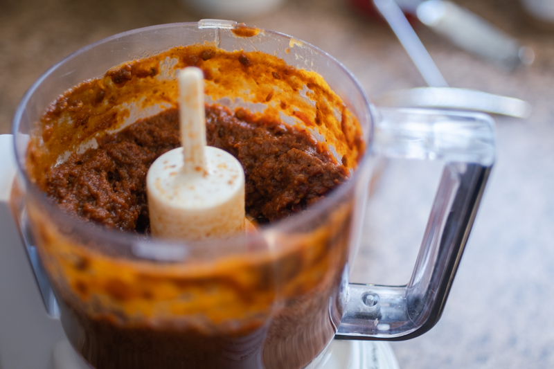 View of food processor  bowl with blended pumpkin and chipotles.