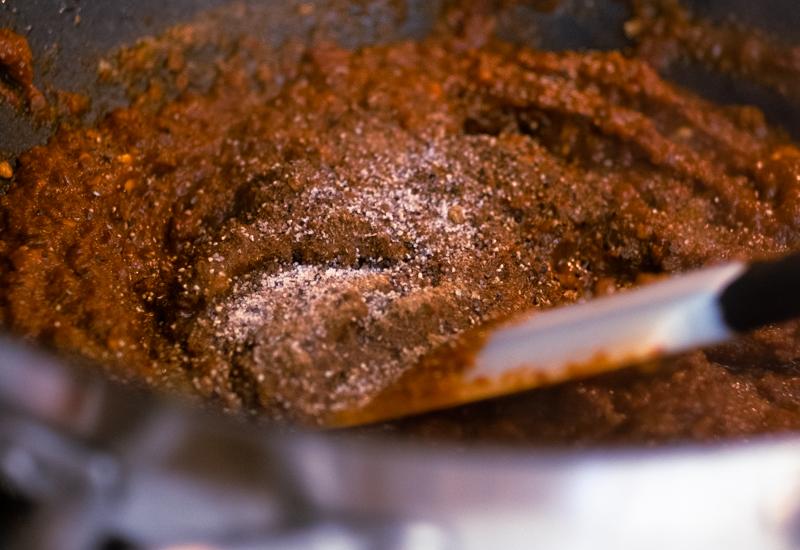 Closeup of blend of paprika, cumin, pepper, and salt.