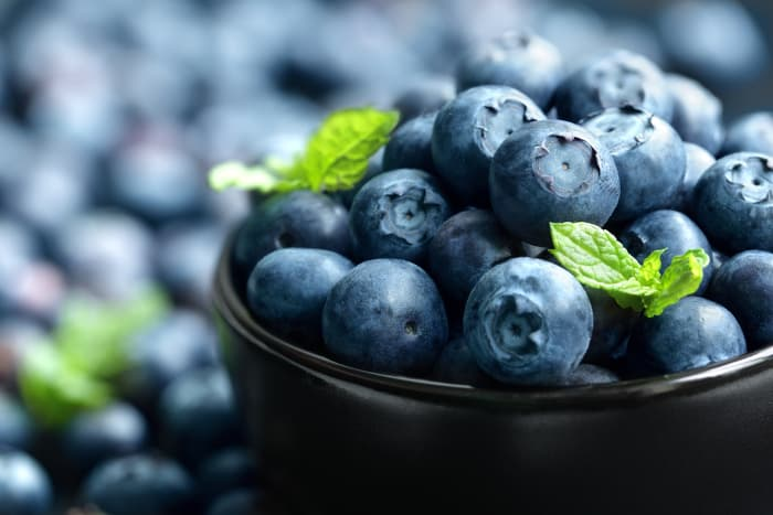 Closeup of bowl of blueberries.