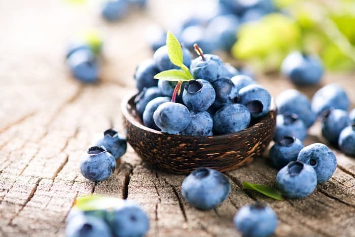 A small basket of blueberries.  The antioxidants in blueberries are only one of the benefits of blueberry nutrition.