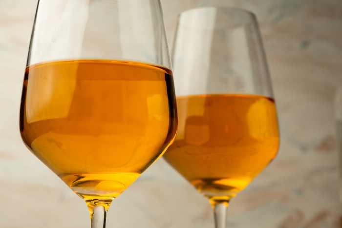 Two glasses of orange wine.
