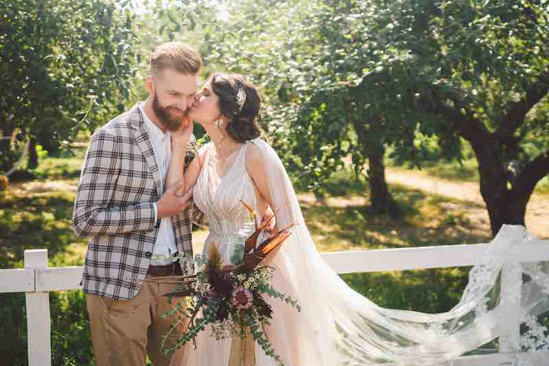 Bride and Groom at their wedding at an orchard. Book your wedding at Deer Lake Orchard.