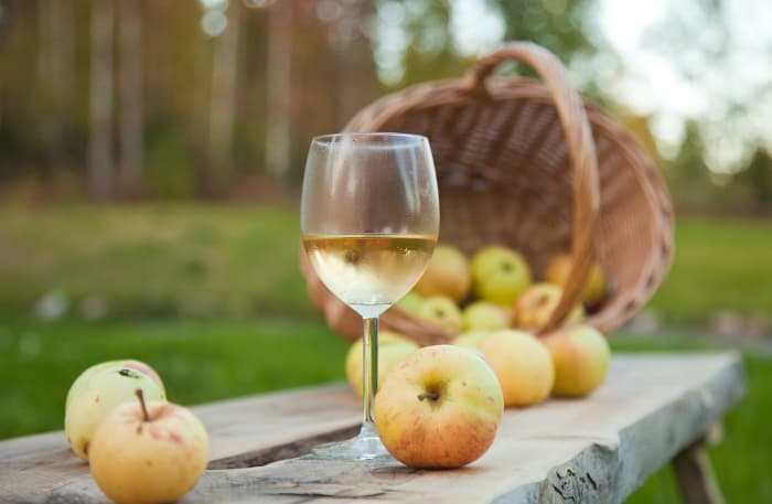 A wine glass with apple cider or wine in it.  Apple wine is one of the unique things you'll find at Montgomery Orchard.