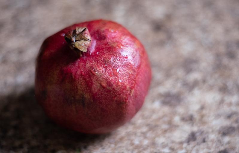 Overhead closeup view of a pomegranate.
