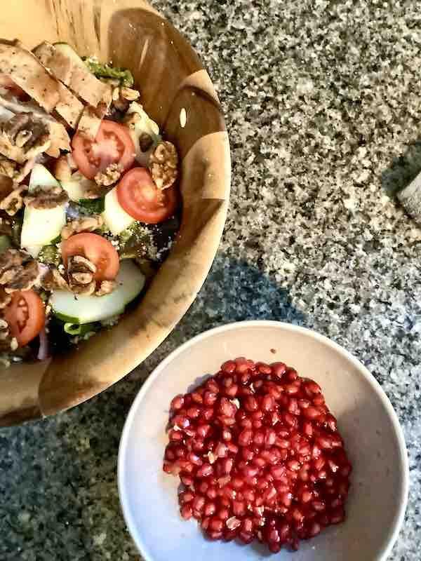 Pomegranates are ready to go in the pomegranate salad.