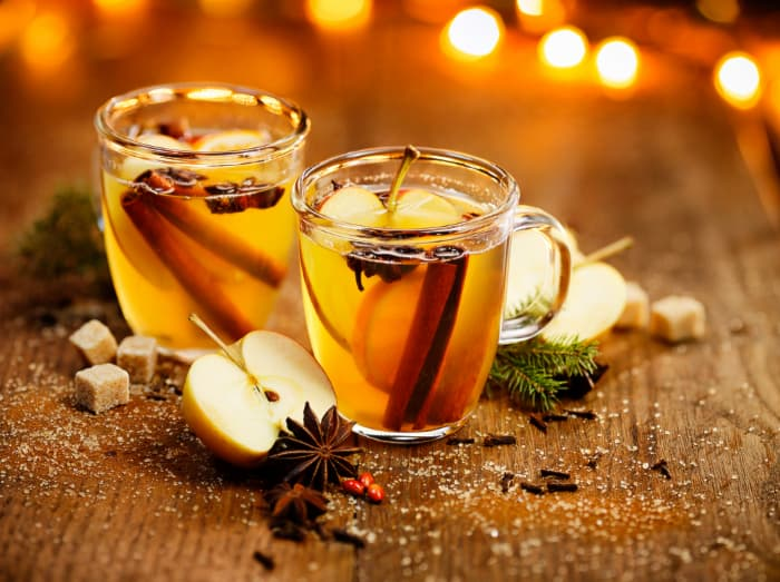 Two glass mugs of mulled cider or wine.  Apple ciders and wines are some of the specialties found at Montgomery Orchard.