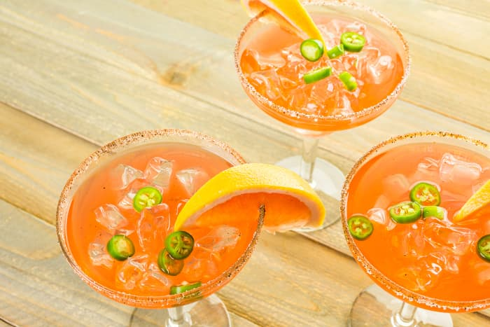 Overhead view of three glasses of spicy grapefruit margaritas -- one of the grapefruit recipes for drinks.