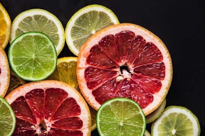 Star Ruby grapefruit slices with slices of lemon and lime.